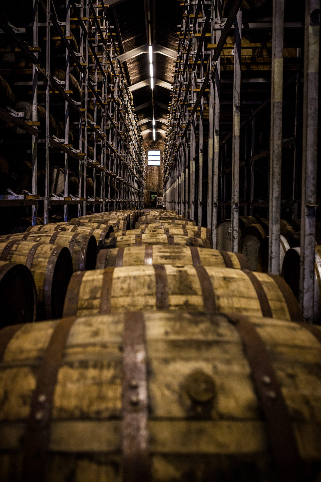 Whisky Casks Stored At Distillery Warehouse in Scotland