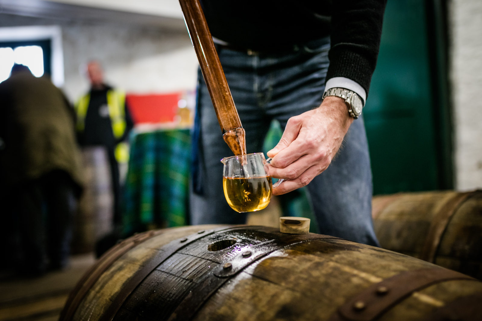 Whisky Sample Being Drawn From A Cask